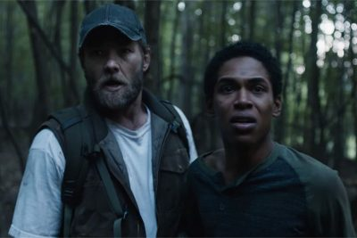 It Comes at Night Review - Joel Edgerton as Paul and Kelvin Harrison Jr as Travis look into the woods