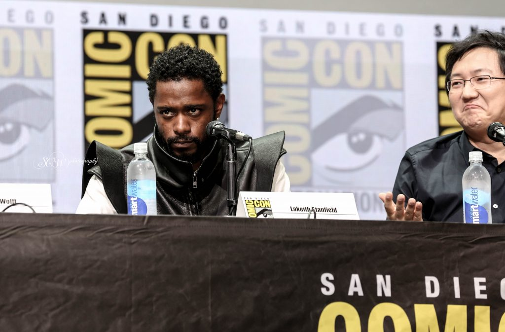 Lakeith Stanfield stares into the crowd at the Hall H Panel for Death Note
