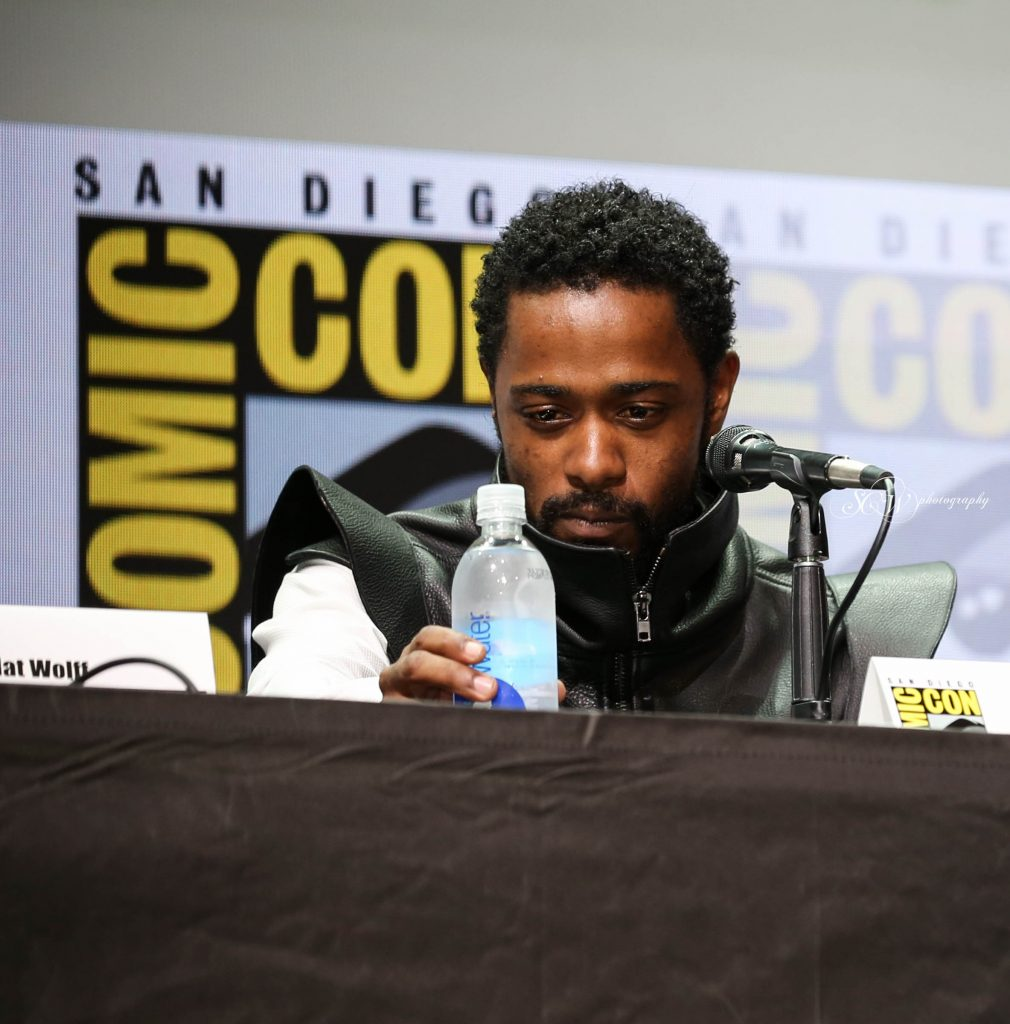 Lakeith Stanfield looks at water bottle at the Hall H panel for Death Note