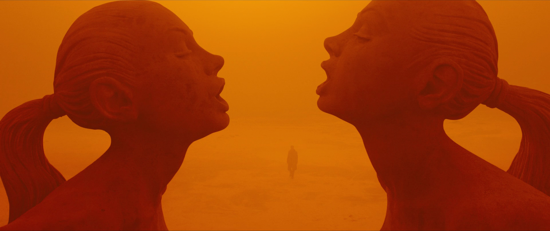 Blade Runner 2049: Statues of two women across from each other leaning in about to kiss
