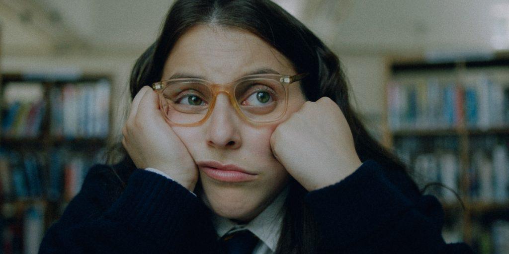Beanie Feldstein (Johanna Morrigan) stares off
