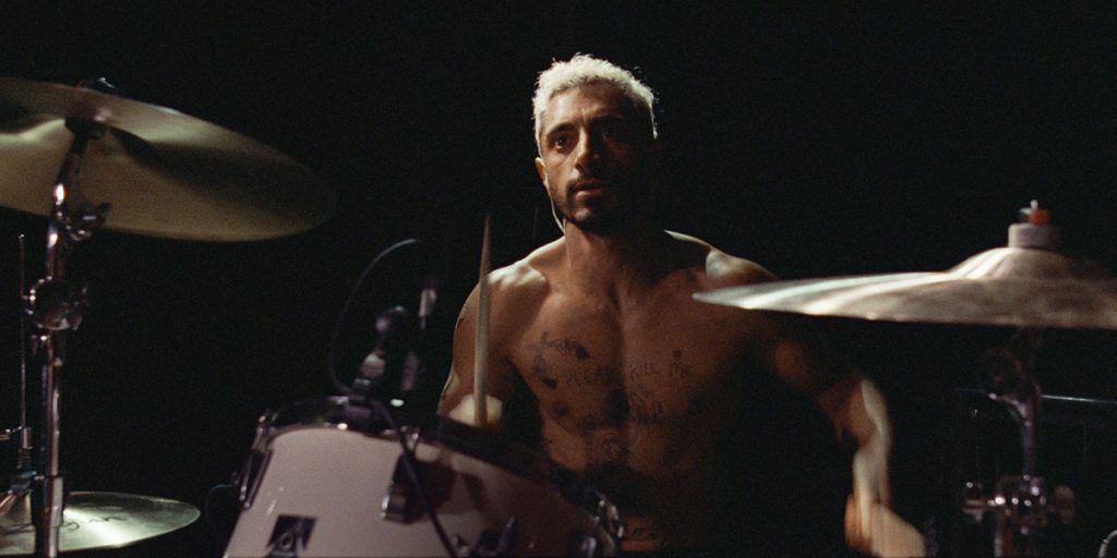 Riz Ahmed (Ruben) plays the drums