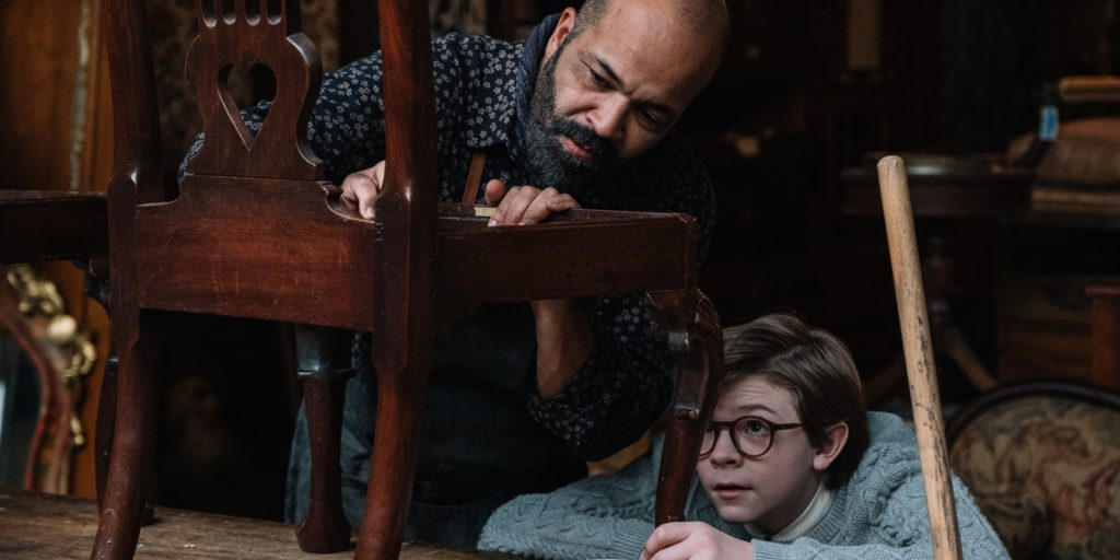 The Goldfinch: Jeffrey Wright (Hobie) and Oakes Fegley (Young Theodore) look at an hold antique chair
