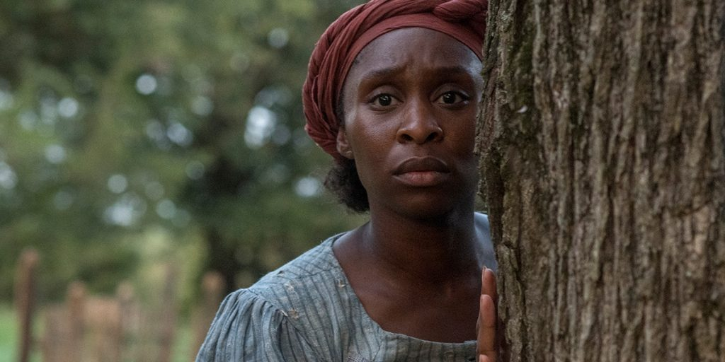 Harriet: Cynthia Erivo as Harriet Tubman hiding behind tree