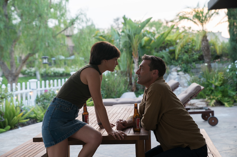 Lucy in the Sky: Natalie Portman sits on table looking at Jon Hamm