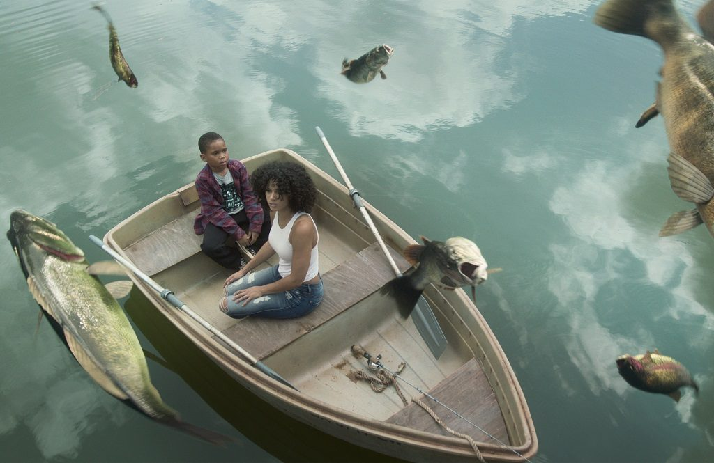Raising Dion: Dion and Nicole sit in a boat as fish rise out of the water