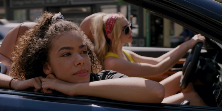 Ginny (Antonia Gentry) rests her head on the window of a convertible while her mother, Georgia (Brianne Howey) drives.